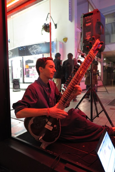 Chris Cook plays the Sitar in the City Arcadia window