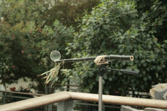 Emily Roderick, Bamboo Telescope, Black bamboo, bi-focal lens, twine and tripod. Photo by Imogen Frost